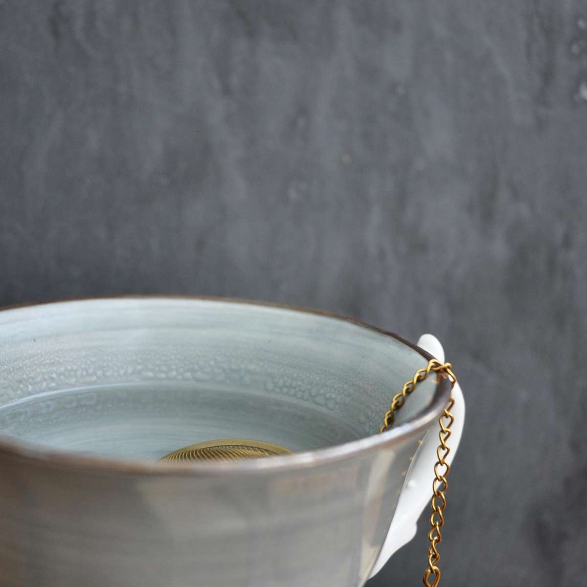 Tea strainer in a cup
